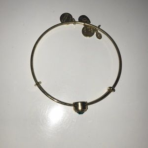 Alex and Ani gold bracelet with emerald charm